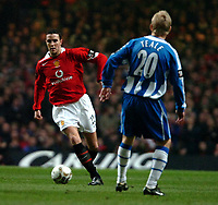 Photo: Ed Godden.<br />Manchester United v Wigan Athletic. The Carling Cup Final. 26/02/2006.John O'Shea (L) takes on Wigans Gary Teale.