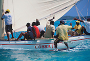 "356204-1200 ~ Copyright: George H. H. Huey ~ Differing opinions aboard ""Cobra"" Bahamian class ""B"" sloop. Annual National Family Island Regatta. George Town, Great Exuma Island, Bahamas."