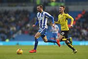 Brighton & Hove Albion centre forward Glenn Murray (17) goes past Burton Albion midfielder Tom Naylor (15) during the EFL Sky Bet Championship match between Brighton and Hove Albion and Burton Albion at the American Express Community Stadium, Brighton and Hove, England on 11 February 2017.