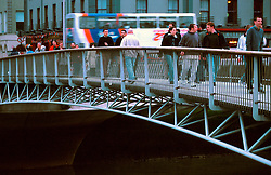 IRELAND DUBLIN MAR00 - Pedestrians use a new footbridge across the Liffey... jre/Photo by Jiri Rezac. . © Jiri Rezac 2000. . Tel:   +44 (0) 7050 110 417. Email: info@jirirezac.com. Web:   www.jirirezac.com