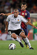 02/09/2012 - Liga Football Spain, FC Barcelona vs. Valencia CF Matchday 3 - Feghouli, argelian player from Valencia CF controls the ball against Mascherano, argentinian defense from FC BArcelona Editorial and Commercial Photographer based in Valencia, Spain | Portraits, Hospitality, News, Sports, Media Coverage for Events
