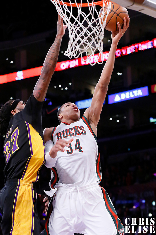 27 February 2015: Milwaukee Bucks forward Giannis Antetokounmpo (34) goes for the layup past Los Angeles Lakers center Jordan Hill (27) during the Los Angeles Lakers 101-93 victory over the Milwaukee Bucks, at the Staples Center, Los Angeles, California, USA.