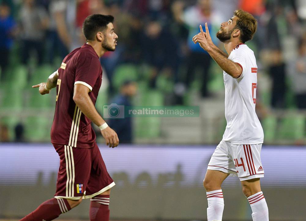 Ali Golizadeh of Iran celebrates after scoring the first goal against Venezuela during international friendly soccer match between Iran and Venezuela at Al Ahli Stadium Doha, Capital of Qatar, November 20, 2018. The match ended with a 1-1 draw. (Credit Image: © Nikku/Xinhua via ZUMA Wire)