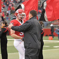 Dec 5, 2009; Piscataway, NJ, USA; Rutgers head coach Greg Schiano shakes hands with cornerback Billy Anderson during the senior ceremony before first half NCAA Big East college football action between Rutgers and West Virginia at Rutgers Stadium.