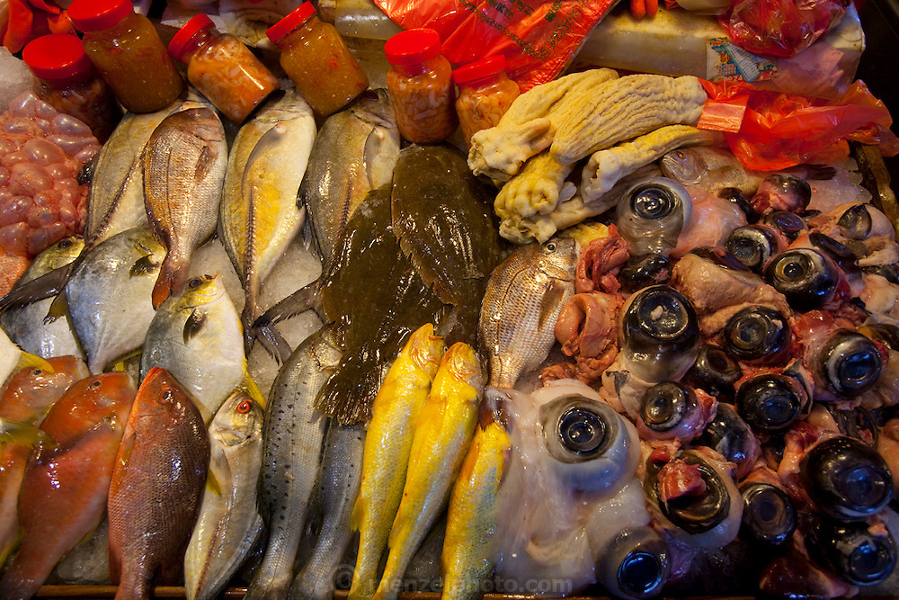 Fish, fish eyes and other varieties of sea food are displayed for sale at the Suao Port, in Taiwan.