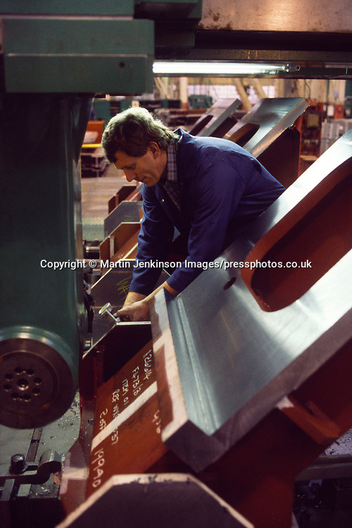 Engineer measuring a component during machining. Davy-Loewy later renamed Davy-McKee Sheffield.