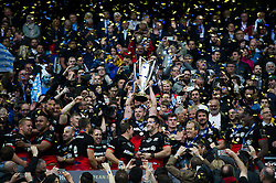 George Kruis of Saracens lifts the European Rugby Champions Cup trophy in celebration - Mandatory byline: Patrick Khachfe/JMP - 07966 386802 - 14/05/2016 - RUGBY UNION - Grand Stade de Lyon - Lyon, France - Saracens v Racing 92 - European Rugby Champions Cup Final.