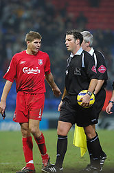 BOLTON, ENGLAND - MONDAY, JANUARY 2nd, 2006: Liverpool's Steven Gerrard argues with referee Mark Clattenburg after the 2-2 draw with Bolton Wanderers during the Premiership match at the Reebok Stadium. (Pic by Dan Istitene/Propaganda)