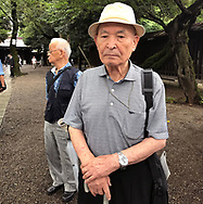 August 15, 2017, Tokyo, Japan: This group of elderly gentlemen, all former members of the Imperial Japanese Army Air Service and veterans of WW II, meet every year at Yasukuni Shrine on the anniversary of the end of World War II. This year it was the 72nd anniversary and tens of thousand came out in the rain to pay their respects for Japan's war dead at Tokyo's Yasukuni Shrine, the national Shinto shrine where nearly 2.5 million war dead from the past 150 years are enshrined. Visits to Yasukuni by top Japanese politicians continue to outrage China and South Korea because it honors 14 World War II class A war criminals who are also enshrined there. Even so, dozens of Japanese lawmakers visited Yasukuni Shrine today, while PM Shinzo Abe sent a ritual offering via his emissary. Photo by Torin Boyd.