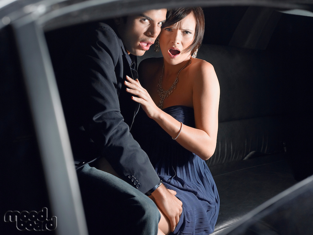 Couple in back of limousine