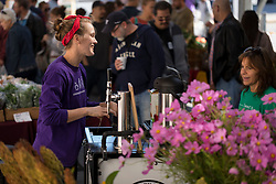 LEXINGTON, Ky., -- Lacey Nguyen owner of Cherry Seed Coffee Roastery sold coffee from her trike at the Lexington farmer's market, Saturday, Jan. 01, 2000 at the Fifth Third Pavillion in LEXINGTON.
