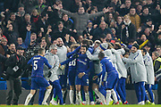 Chelsea players and staff celebrate their win after a penalty shoot out, during the EFL Cup semi final second leg match between Chelsea and Tottenham Hotspur at Stamford Bridge, London, England on 24 January 2019.