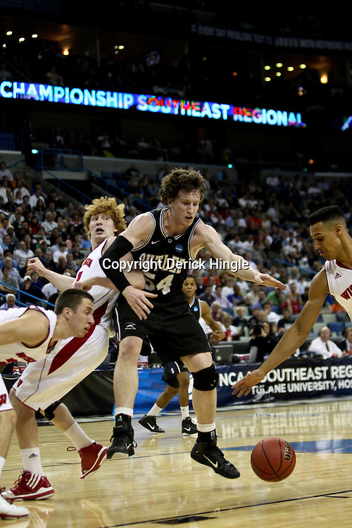 Mar 24, 2011; New Orleans, LA; Butler Bulldogs forward Matt Howard (54) scrambles for a loose ball against the Wisconsin Badgers during the first half of the semifinals of the southeast regional of the 2011 NCAA men's basketball tournament at New Orleans Arena.  Mandatory Credit: Derick E. Hingle