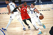 Dallas Mavericks point guard Luka Doncic (77) attempts to drive to the basket while Toronto Raptors  forward Rondae Hollis-Jefferson (4) slips the screen set by  Dwight Powell (7)during an NBA basketball game, Saturday, Nov. 16, 2019, in Dallas. The Mavericks defeated the Raptors 110-102. (Wayne Gooden/Image of Sport)
