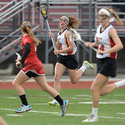 Staff photos by Tom Kelly IV<br /> Haverford's Mairead Janzer (18) runs down the field during the game vs Plymouth Whitemarsh.