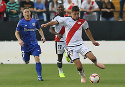 October 24, 2018 - Madrid, Madrid, SPAIN - Muniain of Athletic de Bilbao and Santi Comesana of Rayo Vallecano in action during the spanish league, La Liga, football match between Rayo Vallecano and Athletic de Bilbao on October 24, 2018 at Estadio de Vallecas in Madrid, Spain. (Credit Image: © AFP7 via ZUMA Wire)