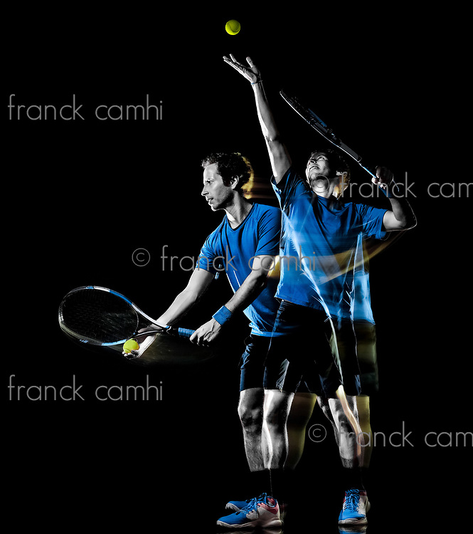 one caucasian tennis player man isolated black background in light painting speed motion multiple exposure