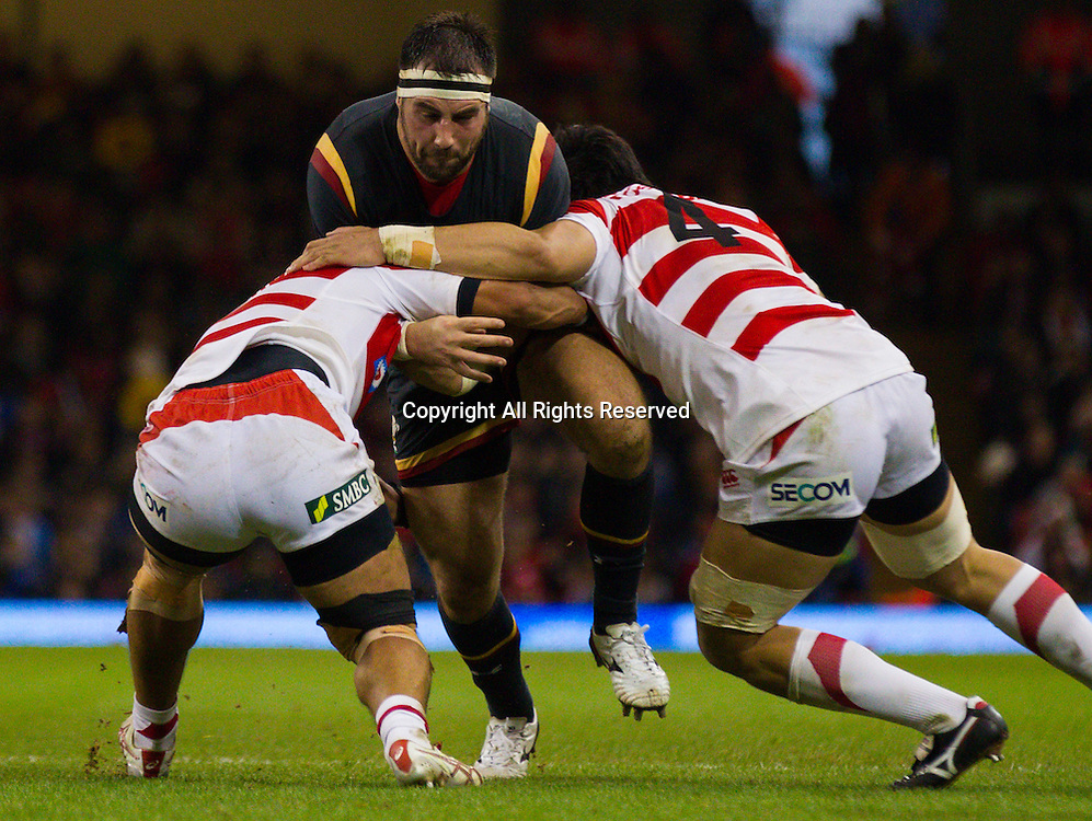 19.11.2016. Principality Stadium, Cardiff, Wales. Autumn International Rugby. Wales versus Japan. Wales Scott Baldwin is tackled by Japans Kyosuke Kajikawa