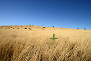 An unmarked cross in the grasslands along Gardner Canyon Road, north of Sonoita, Arizona, USA.