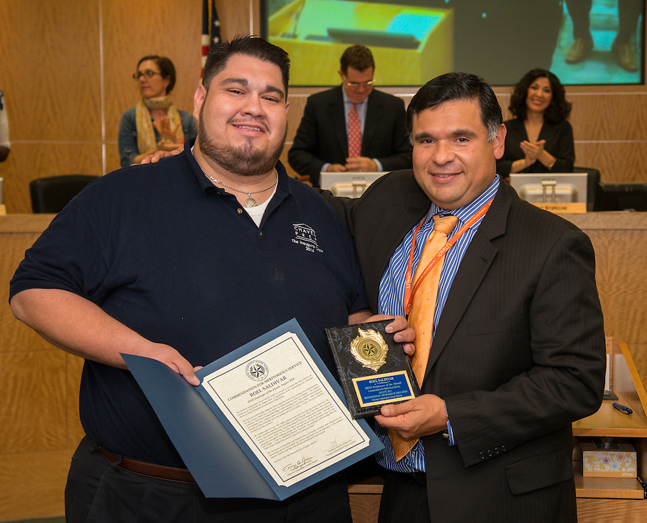 Roel Sanchez , left, is recognized by Chavez High School principal Rene Sanchez, right, as the August district employee of the month during the Houston ISD Board of Education meeting, August 14, 2014.