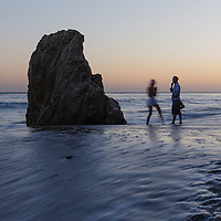 A couple enjoying the sunset at El Matador Beach near Malibu, CA.