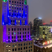 KCP&L Building foreground, Kansas City Missouri's downtown in background, foggy winter evening, January 2019.