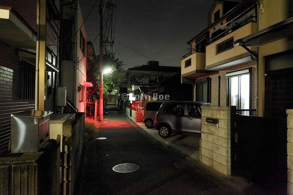 car parking in a residential neighborhood at night Japan