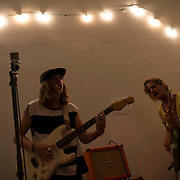 """August 27, 2014 - New York, NY :  Sofar Sounds, which produces """"secret"""" concerts in volunteers' apartments in 37 countries, threw a listening party for the debut of Karen O's new solo album """"Crush Songs"""" -- with performances by the band """"BOYTOY"""" and Julia Easterlin -- in Tribeca on Wednesday evening. The evening concluded with a surprise appearance, and performance, by Karen O and Moses Sumney. Pictured here, from left, Glenn Van Dyke and Saara Untracht-Oakner of the BOYTOYS perform. CREDIT: Karsten Moran for The New York Times"""