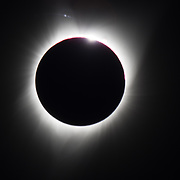 As the moon covers all of the sun, just the corona or aura of plasma remains illuminated. Total Solar Eclipse captured on August 21, 2017 in Salem, Oregon.