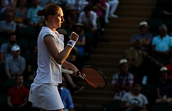 LONDON, July 6, 2018  Alison Van Uytvanck of Belgium reacts during the women's singles second round match against Garbine Muguruza of Spain at the Wimbledon Championships 2018 in London, Britain, July 5, 2018. Alison Van Uytvanck won 2-1. (Credit Image: © Shi Tang/Xinhua via ZUMA Wire)