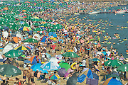 DALIAN, CHINA - JULY 21: (CHINA OUT) <br /> <br /> Crowded Beach<br /> <br /> People enjoy themselves at a beach on July 21, 2013 in Dalian, Liaoning Province of China. <br /> ©Exclusivepix