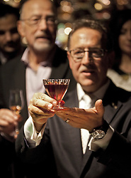 © Licensed to London News Pictures. 11/10/2012. London, U.K..£5,500 A GLASS COCKTAIL. Salvatore Calabrese preparing a cocktail at Salvatore's Bar, 14 Old Park Lane, London today (11/10/2012). .To coincide with London Cocktail Week, he CREATES THE COCKTAIL to break the record with his 'Salvatore's Legacy' cocktail that will be priced at £5,500 a glass. containing 1778 bottle clos de griffier vieux cognac, 1770 pummel liqueur, 1880 dubb orange curacao and two dashes of 1900's angostura bitters..Photo credit : Rich Bowen/LNP