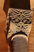 Carved capital with foliage design in the galleries of the Abbatiale Sainte-Foy de Conques or Abbey-church of Saint-Foy, Conques, Aveyron, Midi-Pyrenees, France, a Romanesque abbey church begun 1050 under abbot Odolric to house the remains of St Foy, a 4th century female martyr. The church is on the pilgrimage route to Santiago da Compostela, and is listed as a historic monument and a UNESCO World Heritage Site. Picture by Manuel Cohen