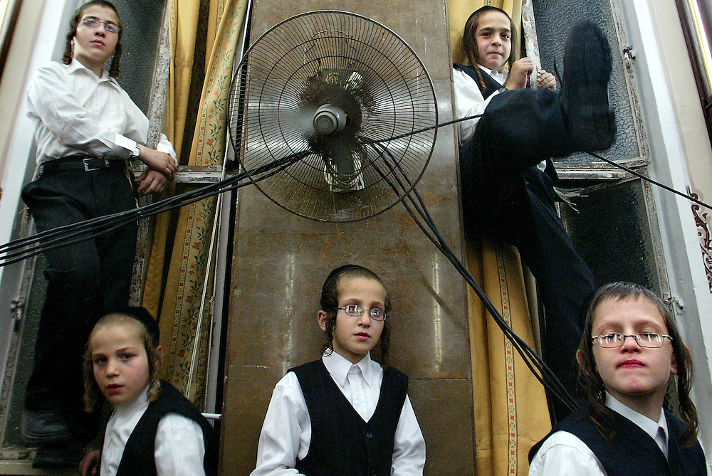 "Ultra Orthodox Jewish youth sit during the Jewish holiday of Rejoicing of the Torah in Jerusalem  on  October 14, 2007. Simchat Torah which means ""rejoicing with/of the Torah"" is one of the happiest days in the Jewish calendar and is marked with festivities in synagogue that include singing, dancing and (typically) a moderate consumption of alcohol. Photo by Olivier Fitoussi /Flash90."