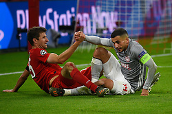 November 6, 2019, Munich, Germany: Thomas Mueller from Bayern (L) and Omar Elabdellaoui from Olympiacos (R) seen in action during the UEFA Champions League group B match between Bayern and Olympiacos at Allianz Arena in Munich. (Credit Image: © Bruno De Carvalho/SOPA Images via ZUMA Wire)