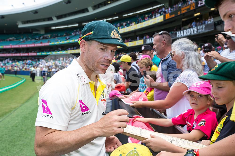 David Warner signing autographs during day 5 of the fifth test match during the 2017/18 Ashes Series between Australia and England at  Sydney Cricket Ground, Sydney, Australia on 8 January 2018. Photo by Peter Dovgan.