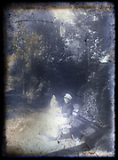 severely deteriorating glass plate with nanny and toddler in  garden setting France ca 1910s