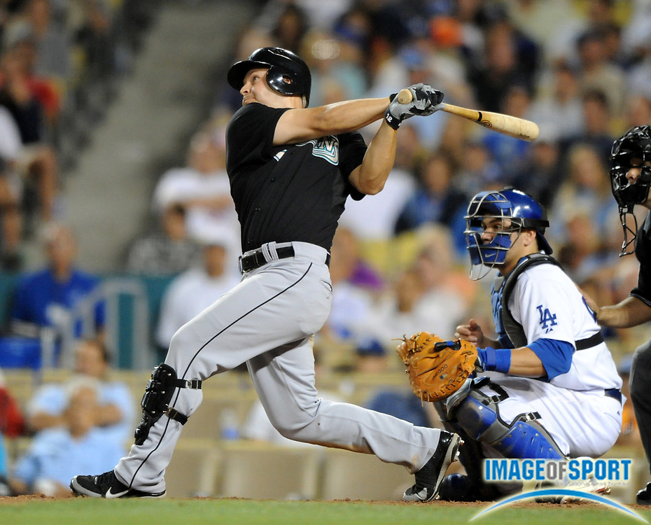 Jul 12, 2008; Los Angeles, CA, USA; Florida Marlins center fielder Cody Ross (12) hits a RBI sacrifice fly in the 11th inning of 5-3 victory over the Los Angeles Dodgers at Dodger Stadium.