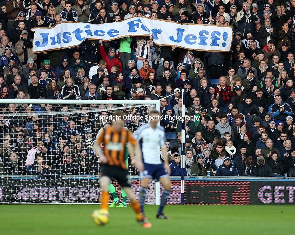 10th January 2015 - Barclays Premier League - West Bromwich Albion v Hull City - West Bromwich Albion fans hold aloft a banner reading 'Justice for Jeff' referring to former striker Jeff Astle - Photo: Paul Roberts / Offside.