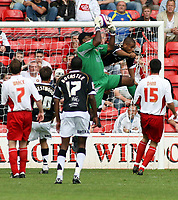 Photo: Mark Stephenson.<br /> Walsall v Port Vale. Coca Cola League 1. 08/09/2007.Walsall's keeper Clayton Ince gets to the ball