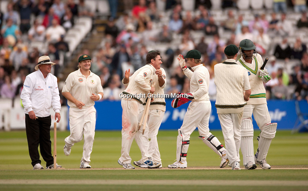 Bowler Marcus North (bare-headed,) is congratulated by team-mates on his 6 for 55 after winning the MCC Spirit of Cricket Test Match between Pakistan and Australia at Lord's.  Photo: Graham Morris (Tel: +44(0)20 8969 4192 Email: sales@cricketpix.com) 16/07/10
