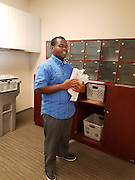 Among his many duties, Ezekiel works in the mail room.