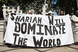 "© Licensed to London News Pictures . 20/06/2010 . London , UK . "" Shariah will dominate the world "" banner . A Muslims Against Crusades demonstraion calling for Sharia Law for All , on Richmond Terrace , Whitehall , opposite Downing Street . Photo credit: Joel Goodman/LNP"
