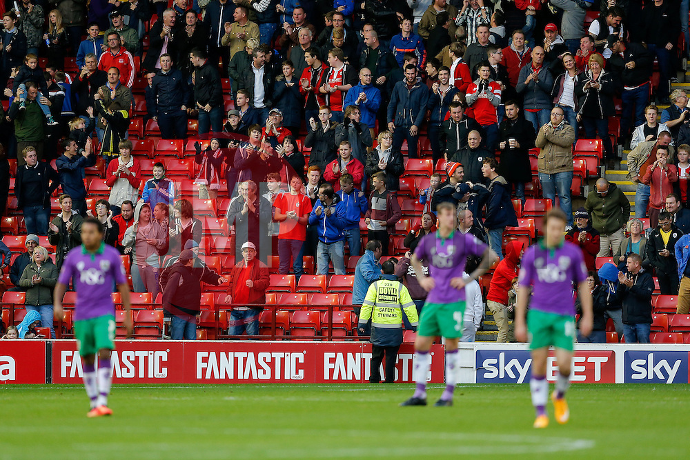 Barnsley fans celebrate behind dejected Bristol City players after an equaliser for Sam Winnall of Barnsley to make it 1-1 - Photo mandatory by-line: Rogan Thomson/JMP - 07966 386802 - 25/10/2014 - SPORT - FOOTBALL - Barnsley, England - Oakwell Stadium - Barnsley v Bristol City - Sky Bet League 1.