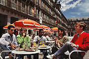 Eating shrimp and other tapas in the Plaza Mayor, Madrid, Spain.