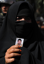 A Yemeni woman holds a picture of her son who was killed during the uprising in 2011, during a demonstration demanding the prosecution of Yemen s former President AlixSaleh in Sanaa, Yemen, January 8, 2013. Photo by Imago / i-Images...UK ONLY