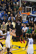 Houston Rockets center Clint Capela (15) dunks over the Golden State Warriors at Oracle Arena in Oakland, Calif., on March 31, 2017. (Stan Olszewski/Special to S.F. Examiner)