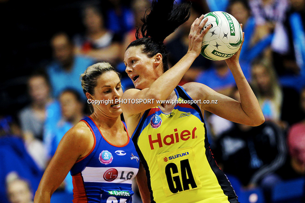 Pulse's Donna Wilkins gets the ball ahead of Mystics' Julie Corletto. ANZ Netball Championship, Northern Mystics v Central Pulse, Trusts Stadium, Auckland, New Zealand. Sunday 21st April 2013. Photo: Anthony Au-Yeung / photosport.co.nz