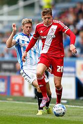 Adam Reach of Middlesbrough is challenged by Jonathan Stead of Huddersfield - Photo mandatory by-line: Rogan Thomson/JMP - 07966 386802 - 13/09/2014 - SPORT - FOOTBALL - Huddersfield, England - The John Smith's Stadium - Huddersfield town v Middlesbrough - Sky Bet Championship.