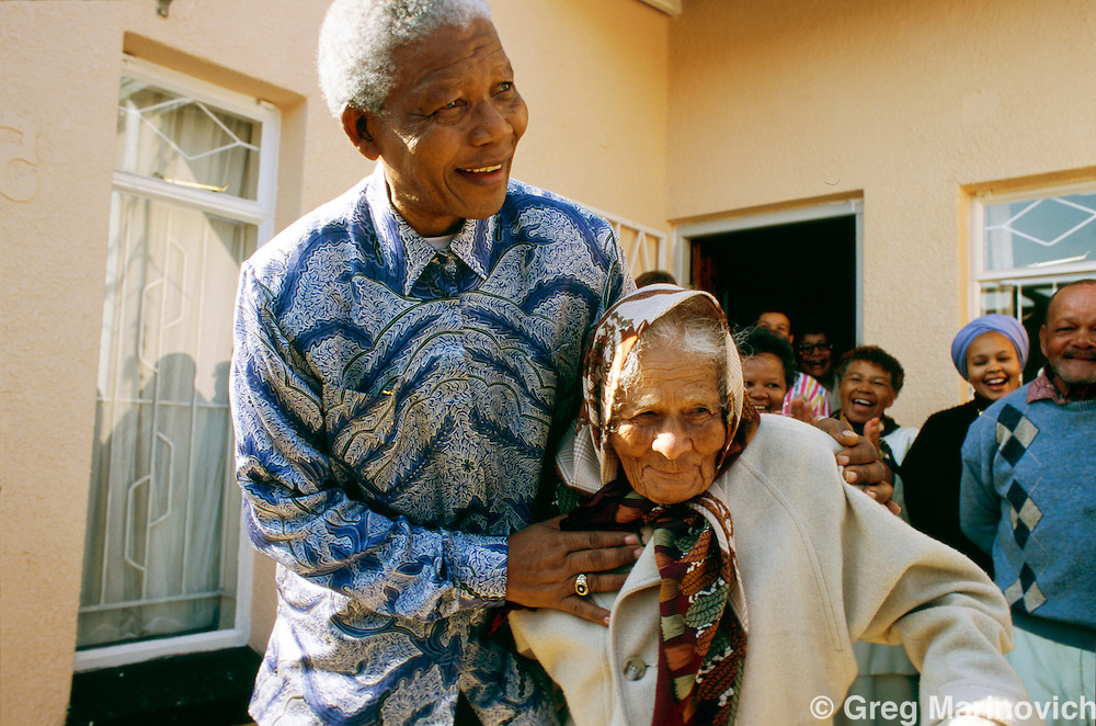Kliptown, Soweto, South Africa. President Nelson Mandela hugs a woman whose family hid him when he was on the run and known as 'The Black Pimpernel' before his arrest ahead of the Rivonia Trial that saw him sentenced to 27 years in jail before emerging to become the first democratic president.